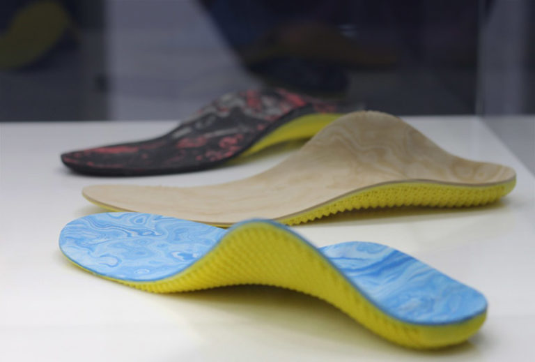 What are the benefits of using orthotic insoles for women and their health?